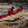 Courageous veteran canoeist Charlie Frisk expertly back-surfing his open canoe in a white water curler of Gilmore's Mistake Rapids at 619 CFS on Section 3 of the wild Wolf River (USA WI White Lake)