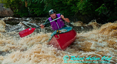 Close-up of whitewater open canoeist Charlile Frisk blasting thourgh a breaking wave-hole as he approaches the final drop of Big Smokey Falls at 744 CFS on Section 4 of the wild Wolf River within Menominee Indian Nation or Menominee County (USA WI Keshena; Obst FAV Photos 2012 Nikon D300s Sports Fun Extraordinaire Image 1574)