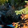 Hiker's view of blazing autumn foliage frames the Cascade River Falls upstream of the MN Highway 61 bridge along the Superior Hiking Trail within Cascade River State Park (USA MN Lutsen; RAO 2012 Nikon D300s Image 3930)