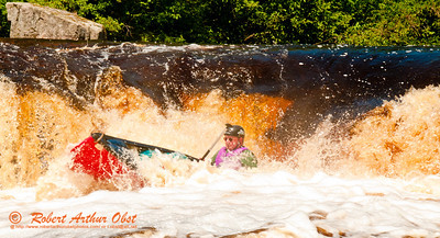 Expert whitewater canoeist Charles Frisk paddling solo into the turbulent mayhem of Sullivan Falls at a river flow of 744 CFS on the wild Wolf River Section 4 within Menominee Indian Nation  (USA WI Keshena)