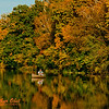 """Blue skies and resplendent autumn colors encircle a fisherman on Indian Lake within Indian Lake County Park (USA WI Cross Plains - RAO 2012 Nikon D300s Image 3576)"""