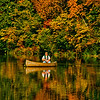 """Blue skies and resplendent autumn colors encircle a fisherman on Indian Lake within Indian Lake County Park (USA WI Cross Plains; Obst Photos 2012 Nikon D300s Image 3577)"