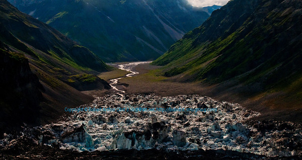Aerial view of dark mountains embracing glacier fed tributaries which flow south from near Kennicott Glacier northwest of Kennicott within Wrangell St. Elias National Park and Preserve (USA Alaska McCarthy)