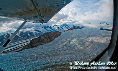 Kennicott Glacier flows southeast past snowy mountains towards Kennicott and Mccarthy within Wrangell St. Elias National Park and Preserve (USA Alaska McCarthy)