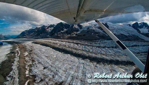 Kennicott Glacier flows southeast past snowy mountains towards Kennicott and Mccarthy within Wrangell St. Elias National Park and Preserve (USA Alaska McCarthy)