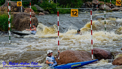 Canoe Solo Men Team Juniors Zachary LOKKEN and Jordan POFFENBERGER and Andre SANBORN of the USA negotiating gates 9 through 12 during the finals of the 2012 ICF Canoe Slalom Junior and U23 World Championships (USA WI Wausau)