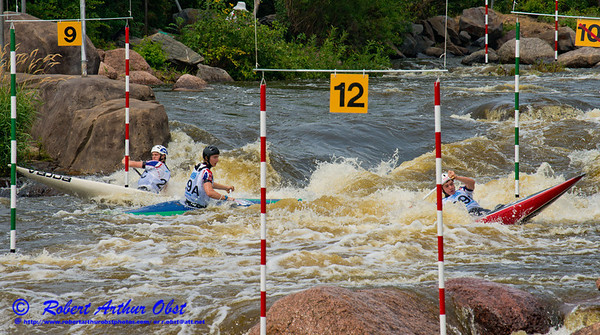 World Championships Silver Medalists Canoe Solo Men Team Juniors Samuel IBBOTSON and Thomas ABBOTT and Andrew HOUSTON of Great Britain negotiating gates 9 through 10 during the finals of the 2012 ICF Canoe Slalom Junior and U23 World Championships (USA WI Wausau; RAO SFE Image 4818)