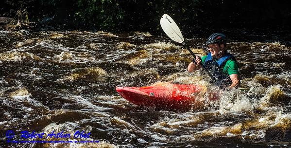 SFE-AO.CK_9480_APC-WolfmanTriathlon.USA.WI.Langlade.WolfRiver.S2.CanoeKayakCompetitorsInSherryRapids.KayakBlasting-B (DSC_9480.NEF)