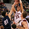 The St. Francis Xavier X-Men's Alberto Rodriguez (L) tries to block the University of Ottawa Gee Gees' Dax Dessureault (R) during their CIS (Canadian Interuniversity Sport) basketball championship consolation semi-final game at Scotiabank Place in Ottawa on Saturday, March 14, 2009. Photo by Patrick Doyle.