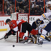 OTTAWA, ONT.: FEBRUARY 6, 2014 -- Ottawa Senators Chris Neil dives for the puck in front of Buffalo Sabres goaltender Jhonas Enroth during the first period of their NHL hockey game in Ottawa, Ont., February 6, 2014. <br /> (Patrick Doyle / Ottawa Citizen)<br />  <br /> (For SPRT story by No Reporter)  ASSIGNMENT NUMBER 115972