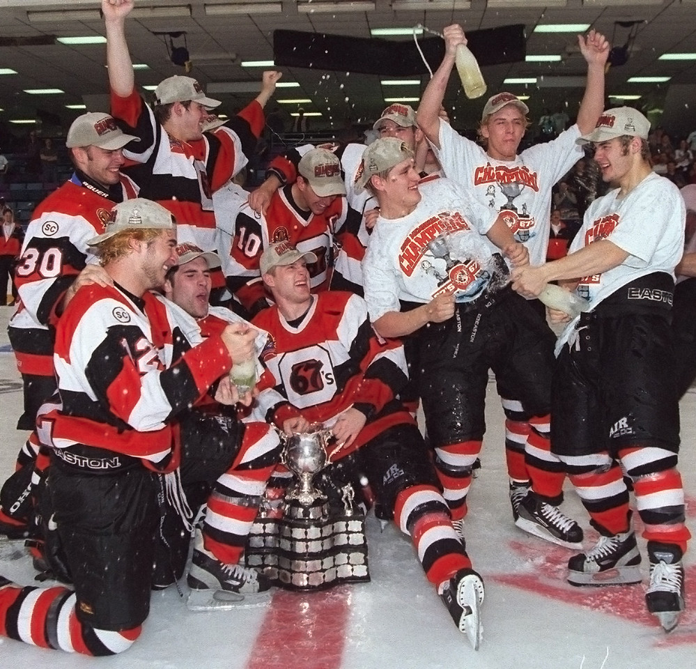The Ottawa 67s celebrate with champagne at centre ice after winning the Memorial Cup. Photo by Patrick Doyle.