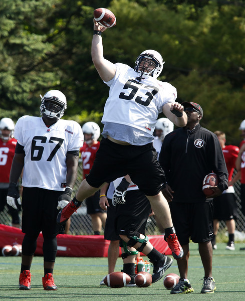Ottawa Redblacks offensive lineman Matthew Albright practices blocking the ball at the second day of CFL training camp at Keith Harris Stadium in Ottawa on Sunday, June 1, 2014.  Photo by Patrick Doyle.