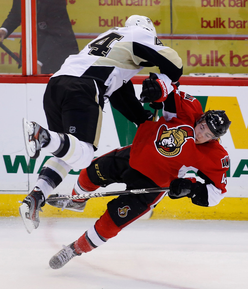 The Pittsburgh Penguins Brooks Orpik, left, and the Ottawa Senators Jean-Gabriel Pageau collide during the third period of game four of their Stanley Cup Eastern Conference semi-final NHL hockey game at Scotiabank Place in Ottawa on Sunday, May 19, 2013. THE CANADIAN PRESS/ Patrick Doyle