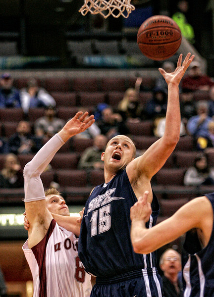 The St. Francis Xavier X-Men's Jeremy Dunn (R) and the University of Ottawa Gee Gees' David Labentowicz (L) jump for the ball during their CIS (Canadian Interuniversity Sport) basketball championship consolation semi-final game at Scotiabank Place in Ottawa on Saturday, March 14, 2009. Photo by Patrick Doyle.