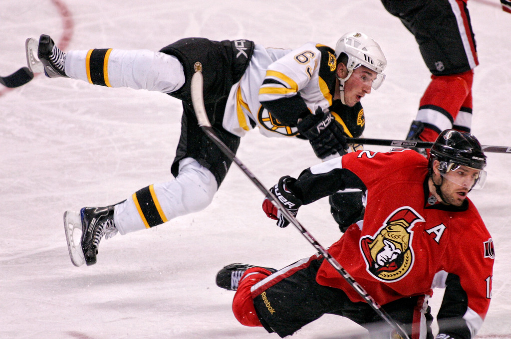 Boston Bruins' Brad Marchand (L) collides with Ottawa Senators' Mike Fisher (R) during the third period of their NHL hockey game at Scotiabank Place in Ottawa October 24, 2009. Photo by Patrick Doyle.