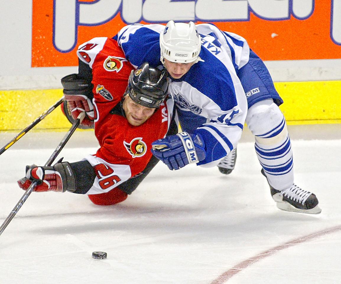 Ottawa-4/12/04-Ottawa Senators vs. Toronto Maple Leafs. Game 3 playoffs. Second period action. Tomas Kaberle tackles Vaclav Varada. Photo by Patrick Doyle.