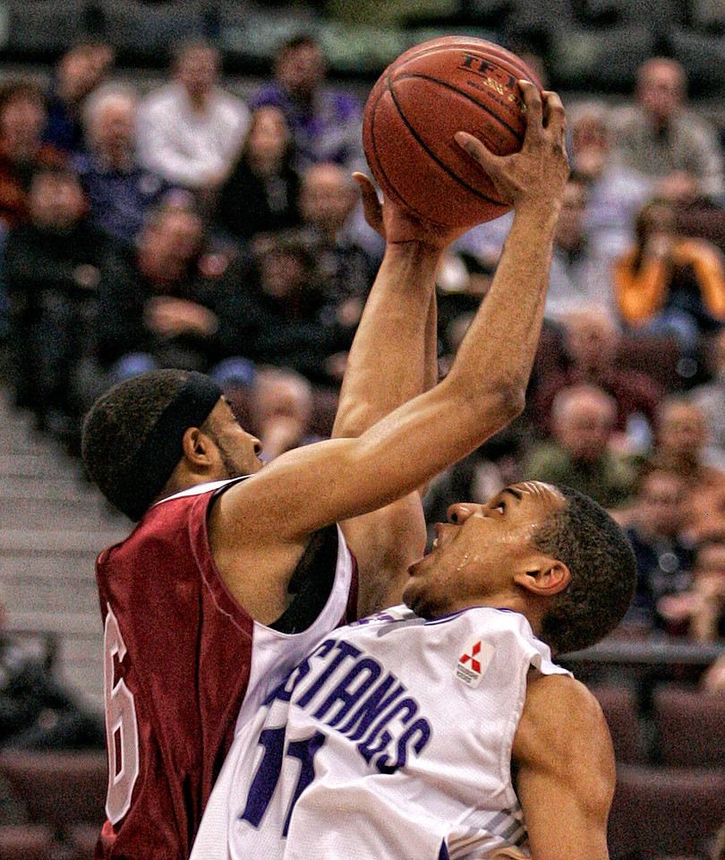The University of Ottawa Gee Gees' Jacob Gibson-Bascombe (L) blocks the University of Western Ontario Mustangs' Andrew Wedemire (R) during their CIS (Canadian Interuniversity Sport) basketball championship first round game at Scotiabank Place in Ottawa on Friday, March 13, 2009. Photo by Patrick Doyle.