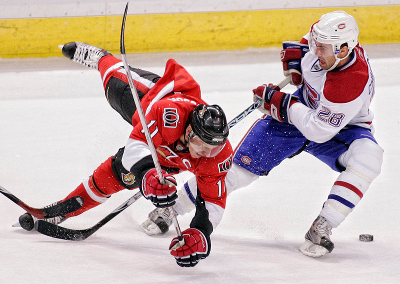 The Montreal Canadiens' Kyle Chipchura (28) topples the Ottawa Senators' Daniel Alfredsson during second period action of their NHL preseason hockey game at Scotiabank Place in Ottawa, Saturday, Sept. 29, 2007. Photo by Patrick Doyle.