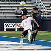 Enid's Geovany Lupercio heads the ball over Union's Eric Villalobos for a goal during the first round of the state playoffs Tuesday, May 4, 2021 D. Bruce Selby Stadium. (Billy Hefton / Enid News & Eagle)