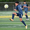 Enid's Miguel Chavez knocks the ball forward against Union during the first round of the state playoffs Tuesday, May 4, 2021 D. Bruce Selby Stadium. (Billy Hefton / Enid News & Eagle)