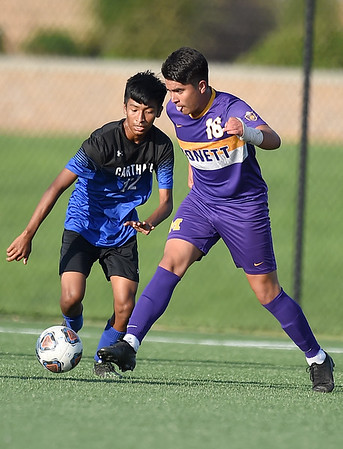 Monett's Jony Perez (16) tries to get past Carthage's Lester Mejia  (12) during their scrimmage at the Joplin Jamboree on Tuesday night at Joplin High School.<br /> Globe   Laurie Sisk