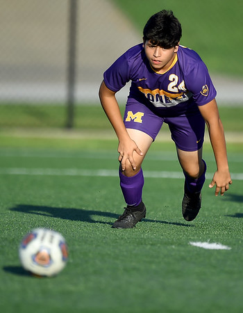 Monett's Juan Sanchez tracks down a loose ball during the Cubs scrimmage against Carthage at the Joplin Jamboree on Tuesday night at Joplin High School.<br /> Globe   Laurie Sisk
