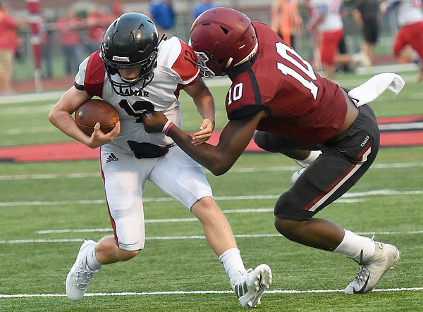 Lamar's Cody O'Sullivan (12) tries to get past Joplin's Kaian Roberts-Day (10) during their portion of the Webb City Jamboree on Friday night at Cardinal Stadium.<br /> Globe | Laurie SIsk