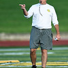 Missouri Southern Head Coach Jeff Sims leads his players through their first practice of the season on Friday night at Fred G. Hughes Stadium.<br /> Globe | Laurie Sisk