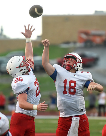 Seneca's Trey Wilson (26) and Lance Stephens (18) try to wrangle and errant snap during their scrimmage against Joplin at the Webb City Jamboree on Friday night at Cardinal Stadium.<br /> Globe | Laurie SIsk