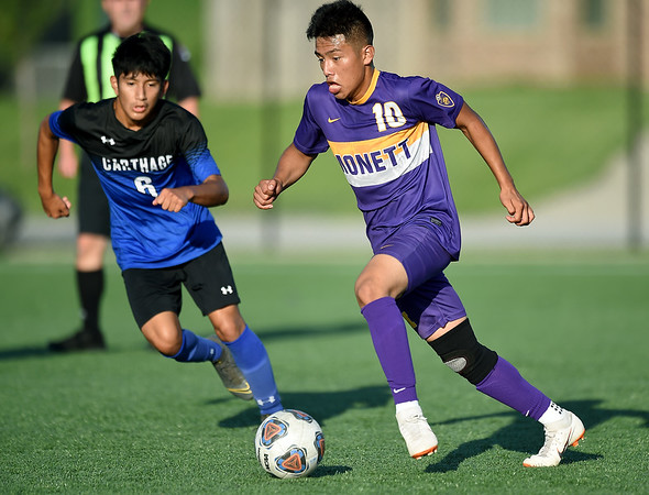 Monett's Esvin Merida (10) tries to get past Carthage's Walter Mejia Cancinos (6) during their scrimmage at the Joplin Jamboree on Tuesday night at Joplin High School.<br /> Globe | Laurie Sisk