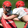 From the left: Aurora linemen Clayton Cordova and William Allen square off during drills on Wednesday at Aurora High School.<br /> Globe | Laurie SIsk