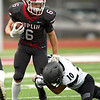 Joplin's Nathan Glades (6) tries to get past Willard's Blaine Willard (10) during the Eagles season opener on Friday night at Junge Stadium.<br /> Globe | Laurie Sisk