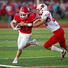 Carl Junction's Cole Stewart tried to defend off Webb City's Jaystin Smith(22) as he runs to the outside in Friday nights game in Carl Junction, Mo.