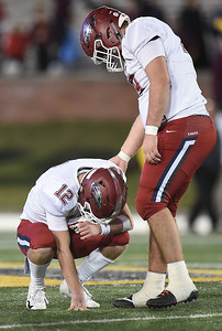 Senior offensive guard Hunter McCleary, right, console senior quarterback Blake Tash (12) after the Eagles fell to DeSmet at the 6A State Championship game on Saturday in Columbia. Globe | Laurie Sisk