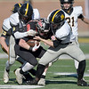 Cassville's DJ White, left and Jacob Olbertz, right, try to bring down Odessa's Luke Malizzi during their Class 3 Championship game on Saturday at Columbia.<br /> Globe | Lurie Sisk