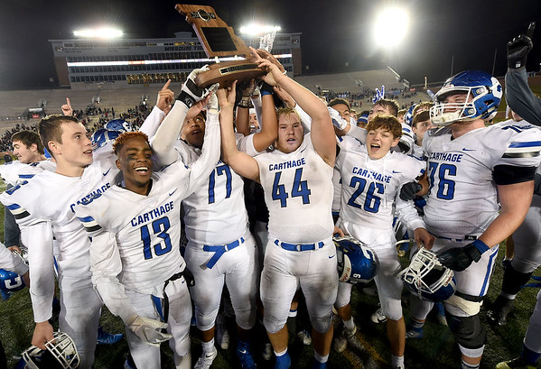 An injured Kale Schrader (44) manages to join his teammates as they celebrate their Class 5 title on Saturday night in Colimbia. Schrader was injured on the final play of the game.<br /> Globe | Laurie Sisk