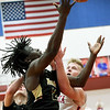 Neosho's Sam Cook, left,  drives to the basket as Seneca's Levi Ketchum defends during their game on Friday night at Seneca.<br /> Globe | Laurie Sisk
