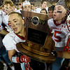 Webb City linebacker Sergio Perez is surrounded by teammates as he holds the Missouri Class 4 Championship trophy on Friday at Columbia after a 48-0 win over Platte County.<br /> Globe | Laurie Sisk