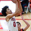 Webb City's Mekhi Garrard (0) puts up a shot as McDonald County's Pierce Harmon (1) defends during their game on Tuedday night at Webb City.<br /> Globe | Laurie Sisk