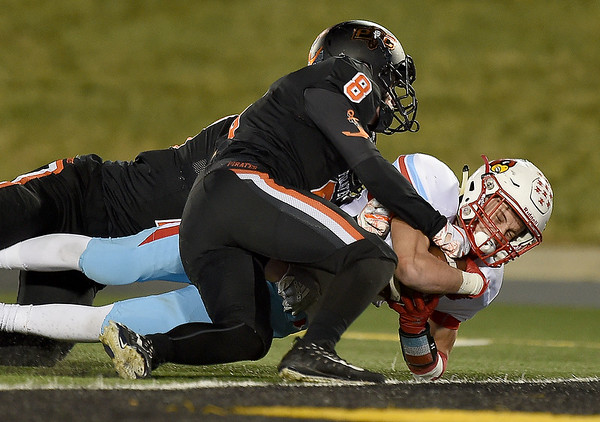 Webb City's Dillom Harlen stretches just short of the endzone to set up the Cardimals' third touchdown during their Class 4 Championship game aganst Platte County on Friday night at Columbia. Defending on the play is Platte County's Trent Rueckert (8).<br /> Globe | Laurie SIsk