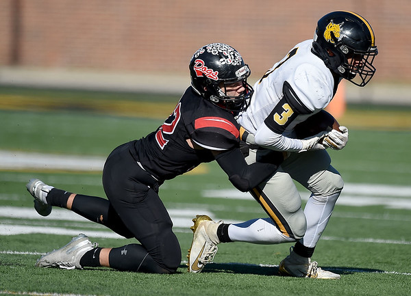 Cassville's DJ White (3) tries to get past Odessa's Blake Heitman (32) during their Class 3 Championship game on Saturday at Columbia. Globe | Lurie Sisk