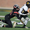 Cassville's DJ White (3) tries to get past Odessa's Blake Heitman (32) during their Class 3 Championship game on Saturday at Columbia.<br /> Globe | Lurie Sisk