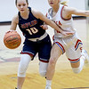 Joplin's Jacie Jensen (10) tries to get past Seneca's xx xx (45) defends during their game on Friday night at Seneca.<br /> Globe | Laurie Sisk