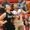 Webb City's Sierra Kimbrough (4) scores as McDonald County's Jaylie Sanny (41) defends during their game on Tuedday night at Webb City.<br /> Globe | Laurie Sisk