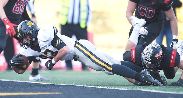 Cassville's Zach Coenen dives into the endzone as Odessa's Luke Malizzi defends during their Class 3 Championship game on Saturday at Columbia.<br /> Globe | Lurie Sisk