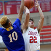 Webb City's Jaystin Smith (22) challenges Parsons' Pierce Thomas (10) during their game in the 4 States Challenge on Saturday night at Webb City.<br /> Globe | Laurie Sisk