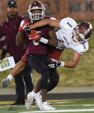 DeSmet's JK Johnson (6) intercepts a pass intended for Joplin's Zach Westmoreland (1) during  the Class 6 State Championship game on Saturday in Columbia.<br /> Globe | Laurie Sisk