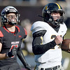 Cassville's Bowen Preddy (34) outpaces Odessa's Bryley Ray (6) for a 60-yard touchdown reception during their Class 3 Championship game on Saturday at Columbia.<br /> Globe | Lurie Sisk<br /> Globe | Lurie Sisk