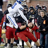 Carthage defensive back MArcus Huntley (13) leaps to defend a pass to Jackson;s Rhet Liley (13)  during their Class 5 Championship game on Saturday night in Colimbia.<br /> Globe | Laurie Sisk