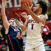 Joplin's Zach Westmoreland (1) drives to the basket as Heritage's Kyle Ingram (40) defends during their game in the 4 States Challenge on Saturday night at Webb City.<br /> Globe | Laurie Sisk
